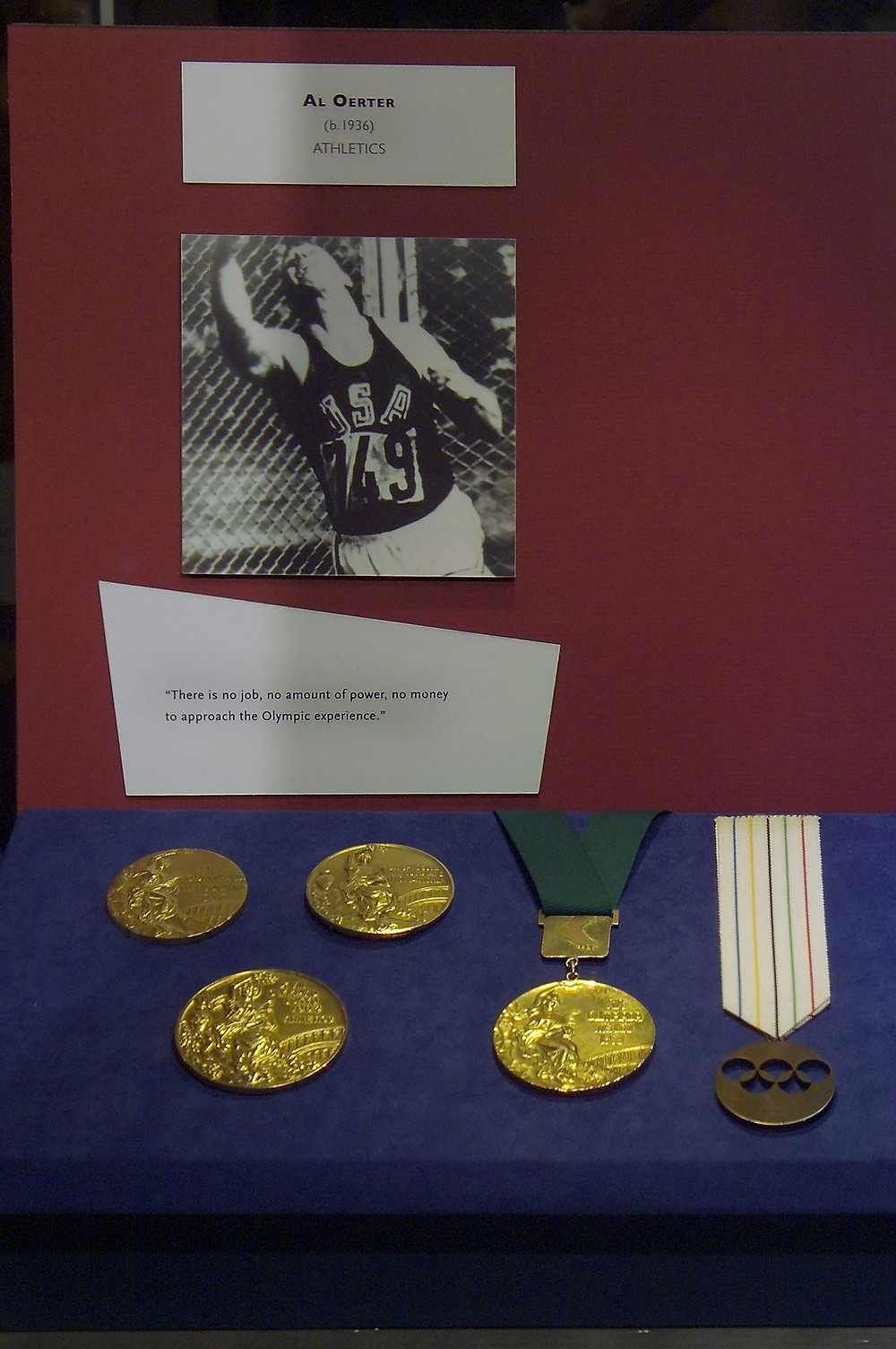 Al Oerter's Reforged Gold Medal with Green Ribbon
