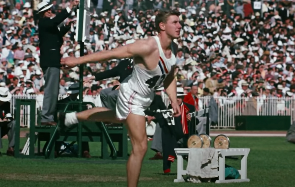 Al Oerter's 1st throw sails to a Olympic new record
