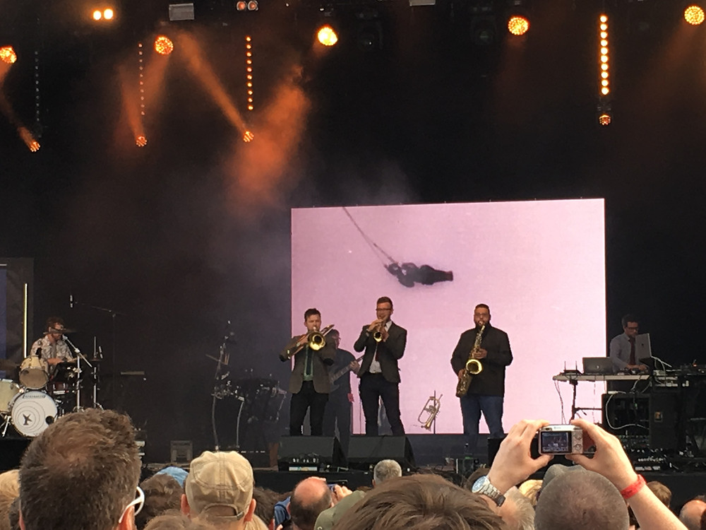 Public Service Broadcasting brass players perform at Bluedot Festival