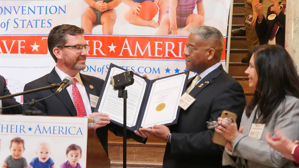 Presenting House Resolution 45 to Lt. Colonel Allen West.