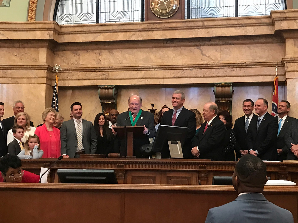 Representative Ray Rodger being honored.
