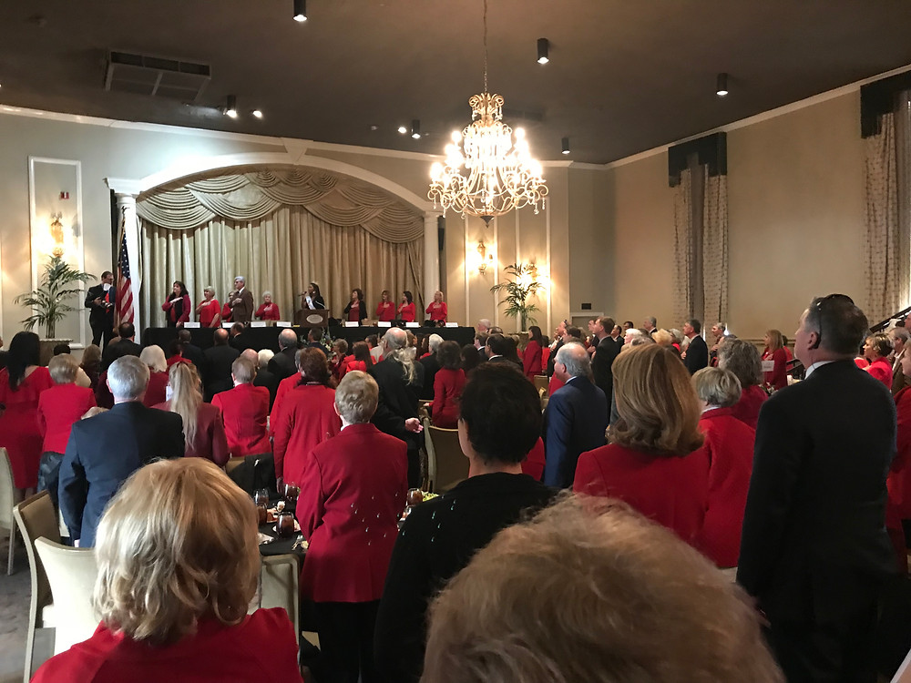 Saying the Pledge at the Mississippi Republican Women's Red Coat Day Luncheon.