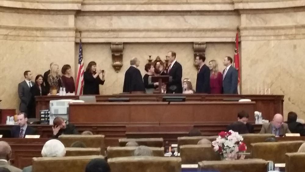 Secretary Hoseman being sworn in.
