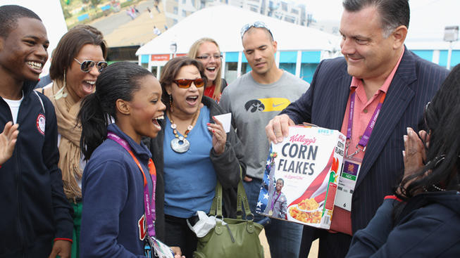 Gabby Douglas on the cover of a Kellog's Corn Flakes cereal box as presented by Steve Penny