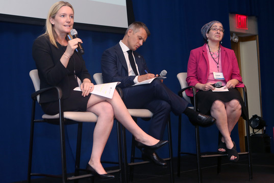 Lauren Gula from the United Nations Global Compact (L), Fabrice Houdart from the Office of the UN High Commissioner for Human Rights (C), and JoAnn Strickon from ManpowerGroup (R) discuss inclusion and gender equality.