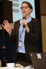 Kate Rebernak, CEO of Framework LLC, addressing the room.