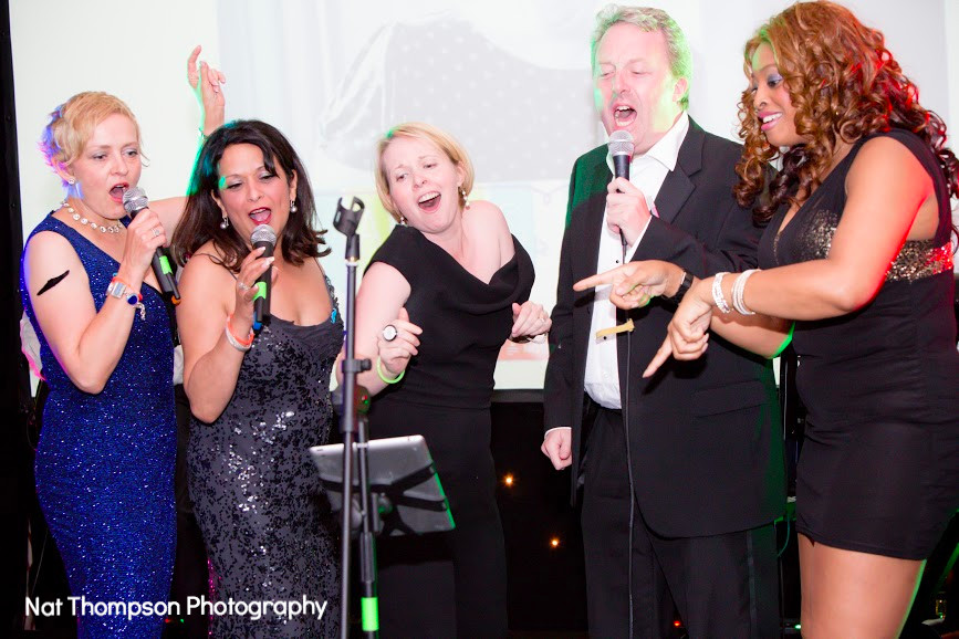Corporate Event Band Charity Entertainment guests singing with live band