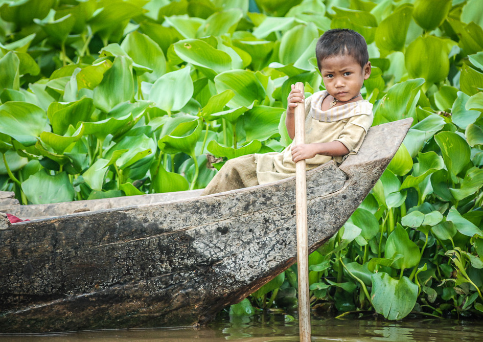 The young boat driver, Kampong Khleang, Cambodia