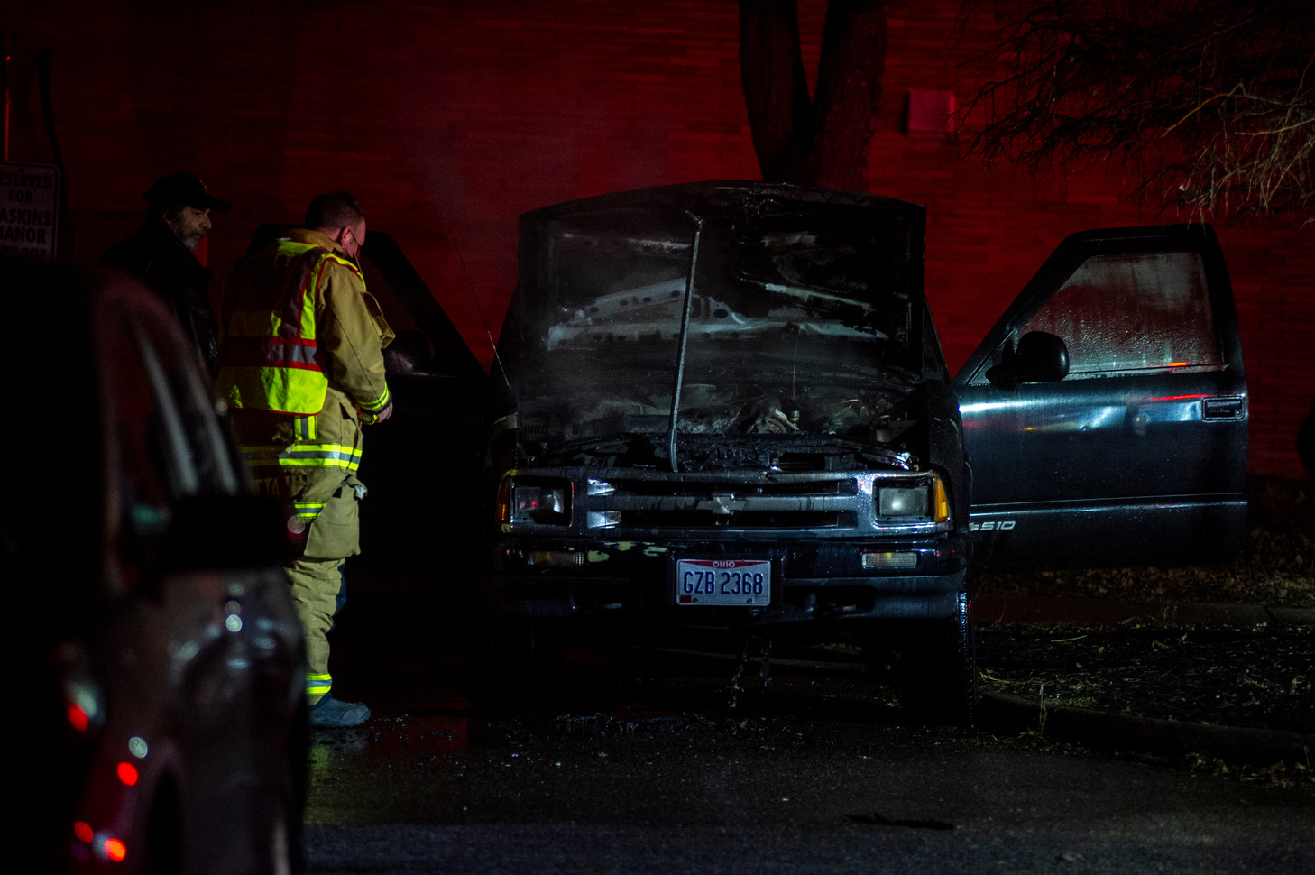 Firefighters work to put out a car fire during a county wide power outage in Athens, Ohio, on Friday, Jan. 22, 2021.