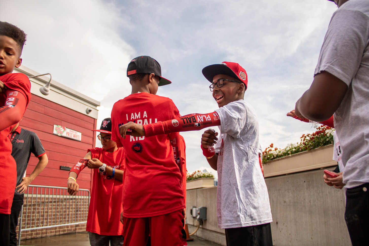 The Cincinnati Reds hold the Play Ball Event which brings kids baseball and softball teams together with some Cincinnati celebrities to promote getting out and playing sports.