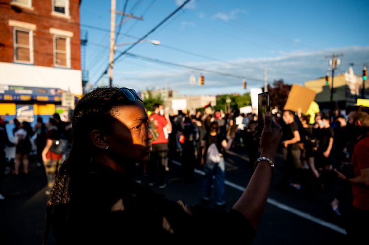A bystander records a Black Lives Matter protest in Cincinnati, Ohio, days after George Floyd was killed by police officers in Minneapolis.