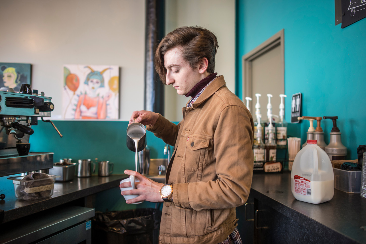 Zach Swelbar making a coffee at True West Coffee in Hamilton, Ohio. Swelbar has worked there, part time, for the past two years while also persuing music as the lead vocalist in Circle It.