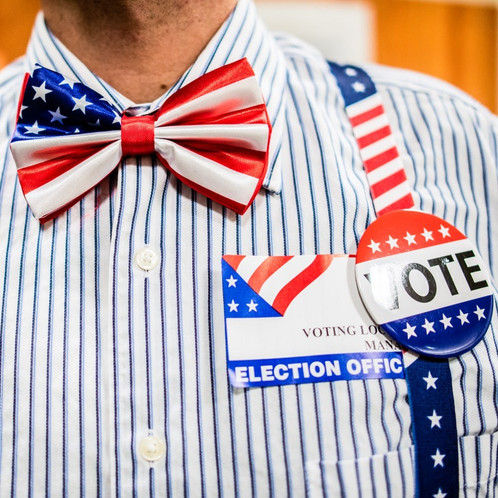 """Tristan Olson, who has lived in Athens since 2013, dresses up to work the polls to """"put a brighter spot on a more civic duty."""""""