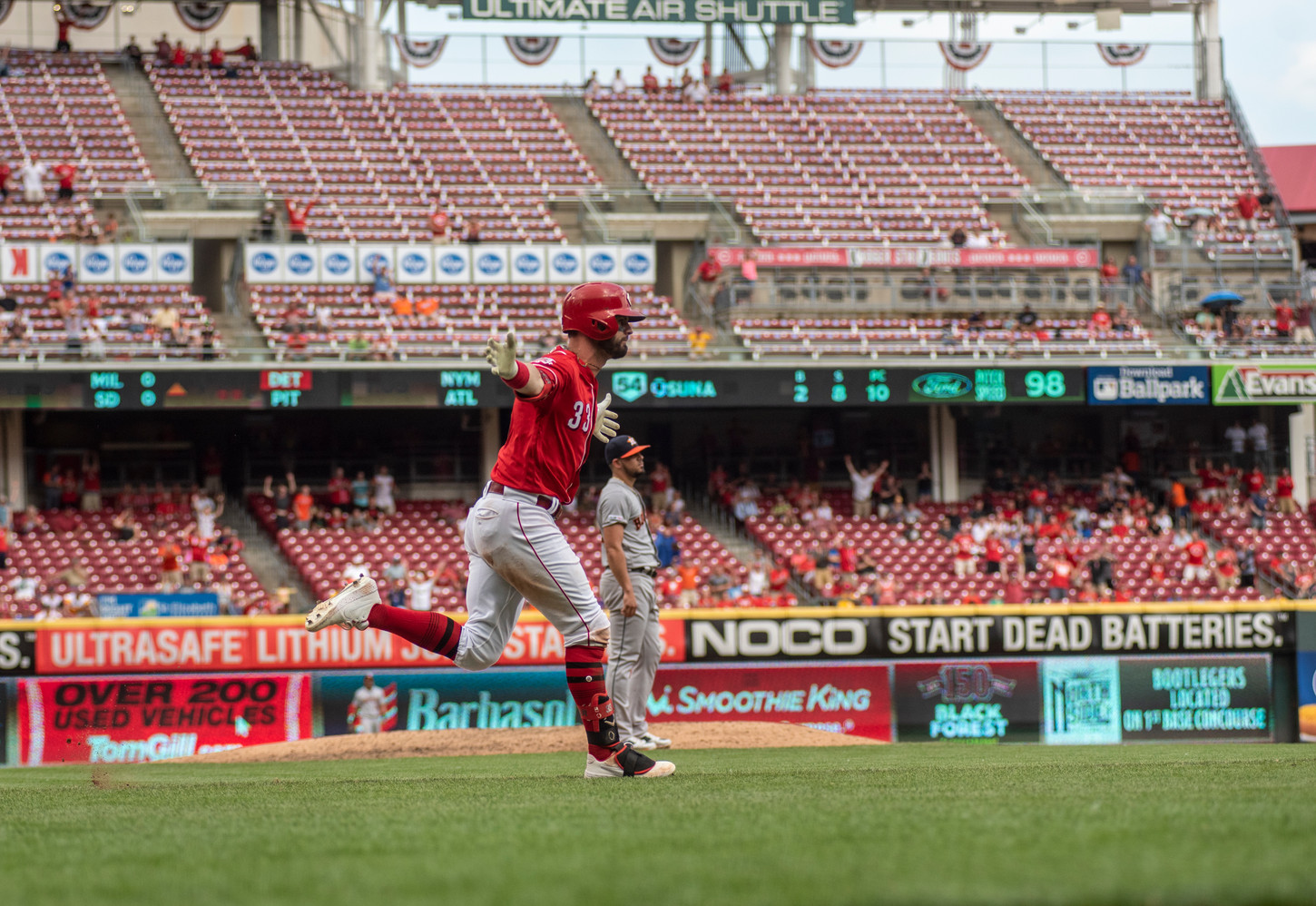 Jesse Winker runs the bases after hitting a homerun to win the game.