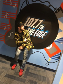 Dutch The Dreamer catching a flick in front of 107.7 FM