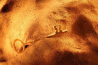 Found opportunity, key in sand.jpg