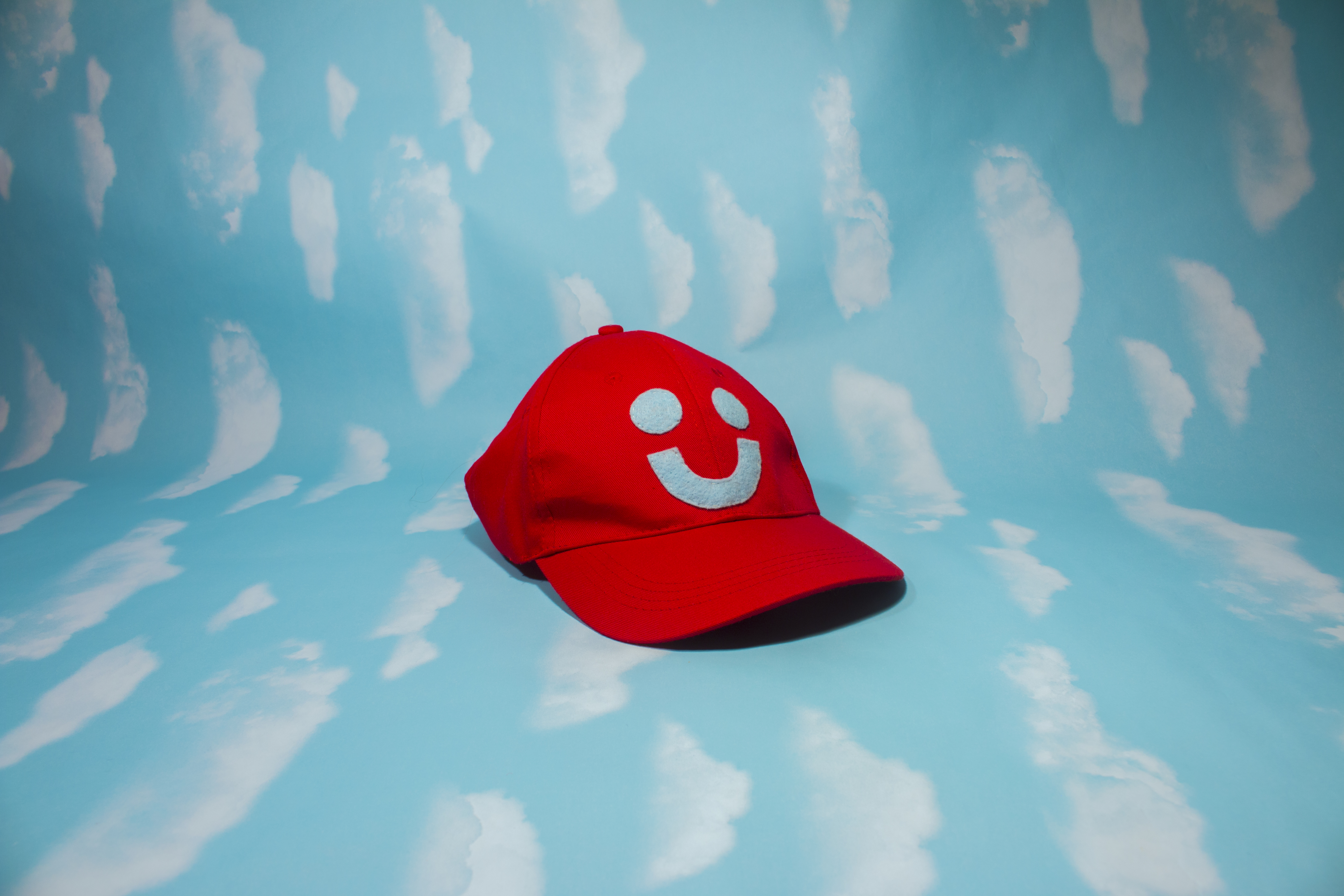 red smiley hat