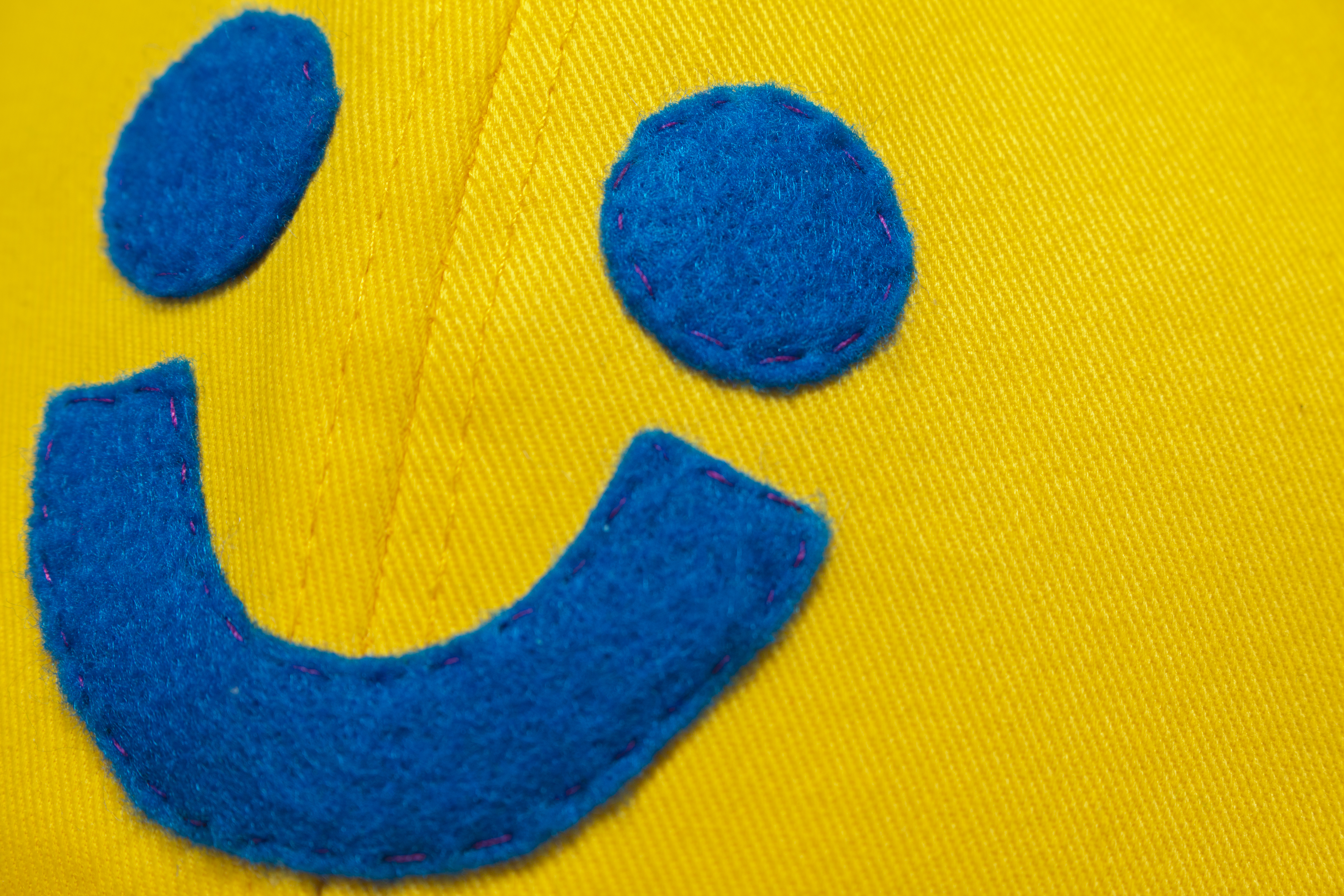 yellow smiley hat