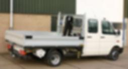 VW transporter met pickup bak en laadkraan van IJntema