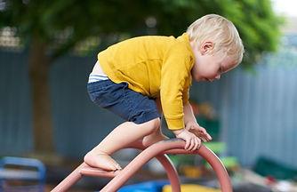 CleverKids-boy-climbing-yellow-jumper_ed