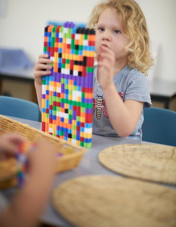 CleverKids-girl-building-coloured-blocks