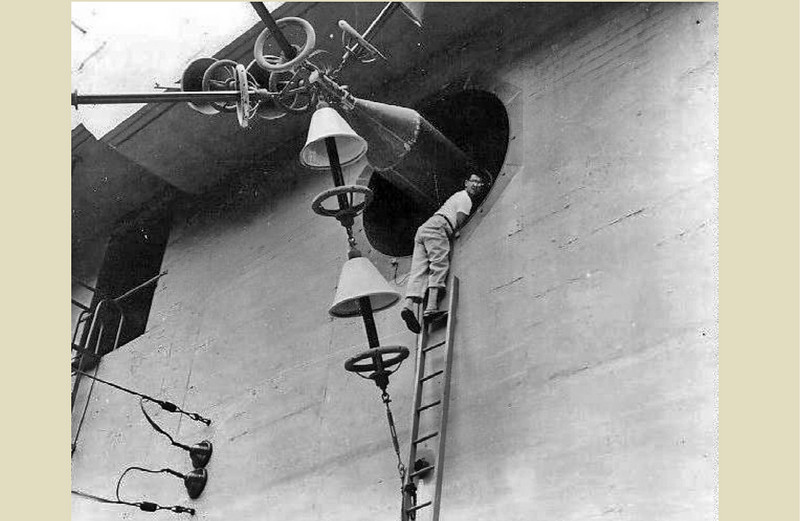 A naval engineer attends to one of the antennae housed in the Omega Station in Ha'iku Valley.
