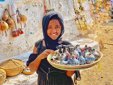 Ethiopia gilr selling pottery.jpg