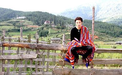 Bhutan Karma sitting on fence.jpg