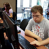 Young Man with downs on computer.JPG