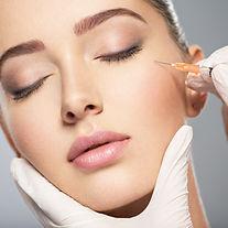 Woman getting cosmetic injection of botox near eyes, closeup. Woman in beauty salon. plast