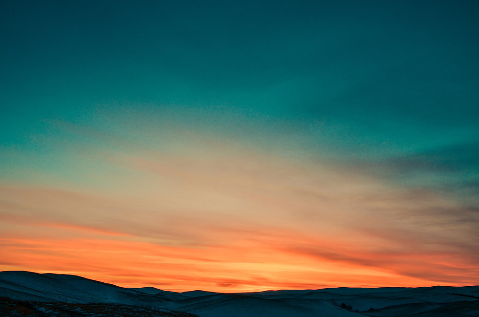 Canva - Sunset over Snow Covered Mountai