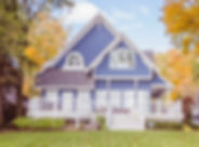 Blue home built in Delavan Wisconsin with beautiful trees changing the color of their leaves