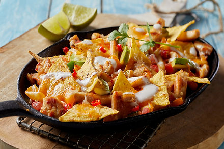 Spicy Mexican chicken with nachos and fr