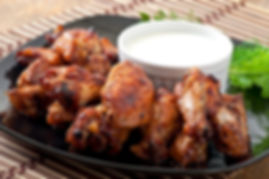 Baked chicken wings in the Asian style.j