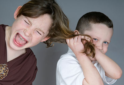 Bully boy pulling girl's hair.jpg