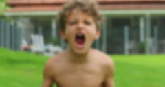 _Child boy yelling kid screaming looking
