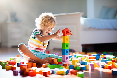 Child playing with colorful toy blocks.