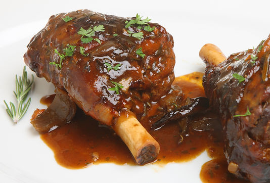 Lamb shanks with a rich onion gravy..jpg