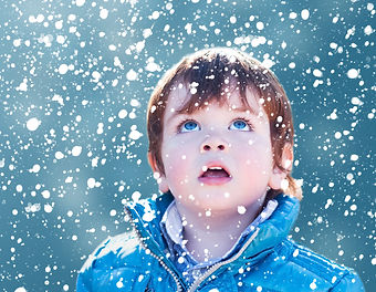 Child looking snow falling with his mout