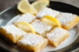 Zesty sweet lemon bars with lemon garnis