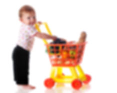 A barefoot baby girl _shopping_ for groc