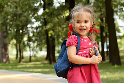Beautiful little girl with backpack walk