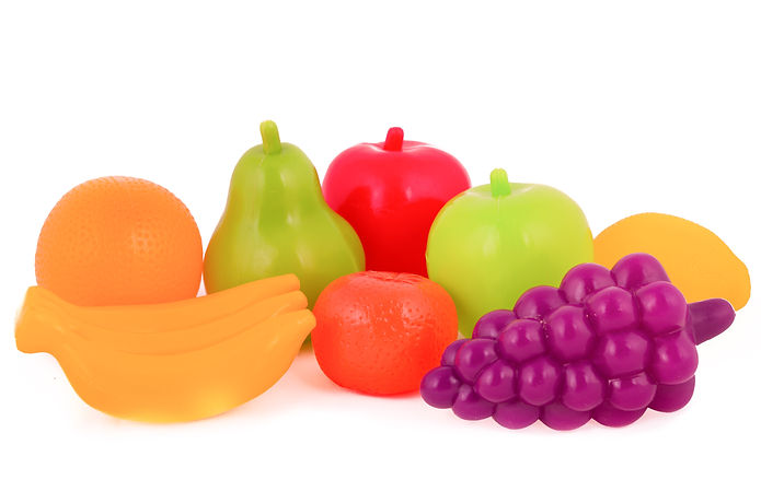colorful plastic food over white backgro