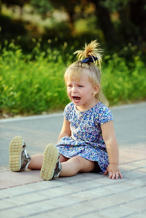 a crying little funny toddler girl outdo