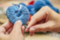 Handmade pompons. The process of making