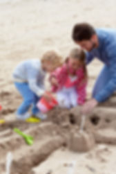 Father And Children Building Sandcastles