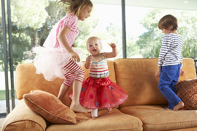 Group Of Children Jumping On Sofa.jpg