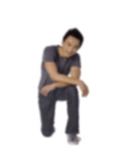 Portrait of smiling teenage guy kneeling