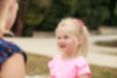 Little girl talking to her mom.jpg