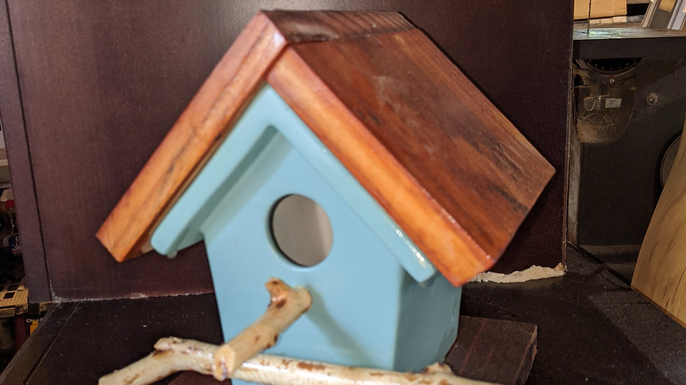 Small barnwood covered birdhouse
